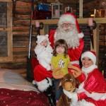 Op de foto met de Kerstman, kerstvrouw, rendier in Kersthuis